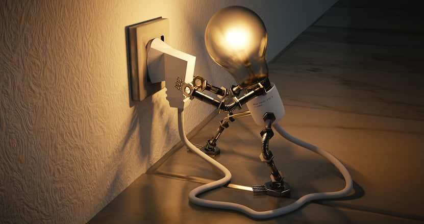 Glödlampa sätter i elkontakt